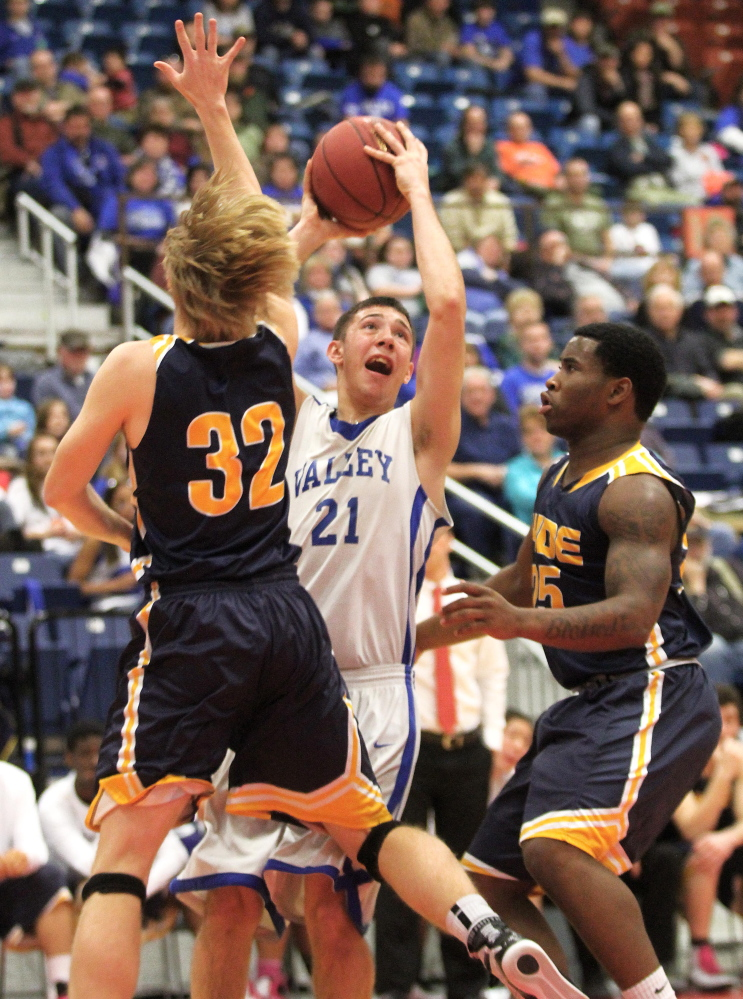 Valley High School's Collin Miller attempts to put up a shot between Hyde School's Frederik Lasson (32) and Shemar Jack (25) during the first half the Cavaliers' 61-47 loss in a Western Class D semifinal game at the Augusta Civic Center on Wednesday.