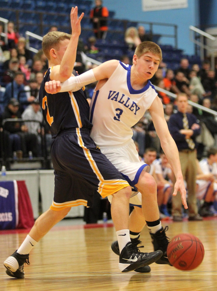 Valley High School's Cody Laweryson tries to dribble around Hyde School's Keifer Cundy during the first half of the Cavaliers' 61-47 loss in a Western Class D semifinal game at the Augusta Civic on Wednesday.