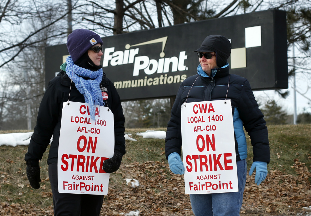 Fairpoint employees Amber Lyman, left, and Julie Sawtelle picket outside the company's offices in Portland last month. The strike, which entered its 127th day Friday, is the longest in the telecommunications industry this century and involved about 1,700 workers in northern New England, including 800 in Maine.
