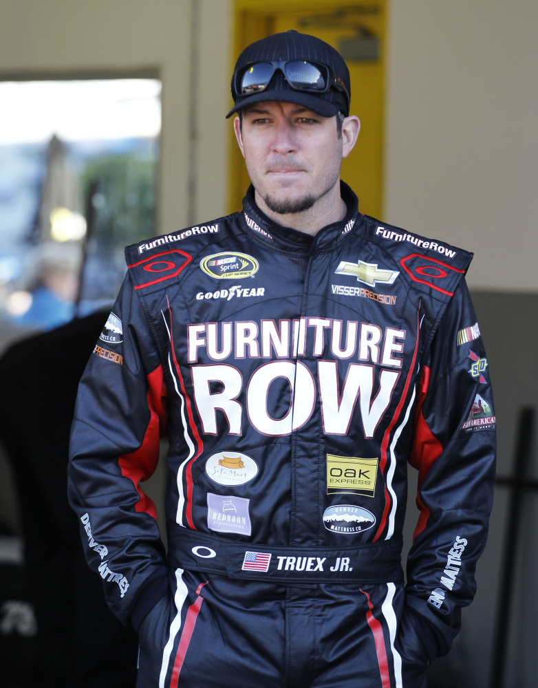 Martin Truex Jr. battled a bad car on the track at the same time his girfriend fought cancer. He's ready to put 2014 behind and move on to better times.