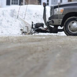 A private plow truck cleans up a road Thursday in Hallowell after removing snow from a driveway.