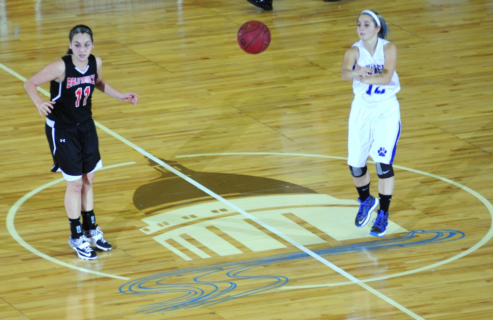 Brunswick's Julia Champagane, left, watches as Lawrence's Dominique Lewis passes at midcourt during an Eastern A semifinal Wednesday at the Augusta Civic Center.