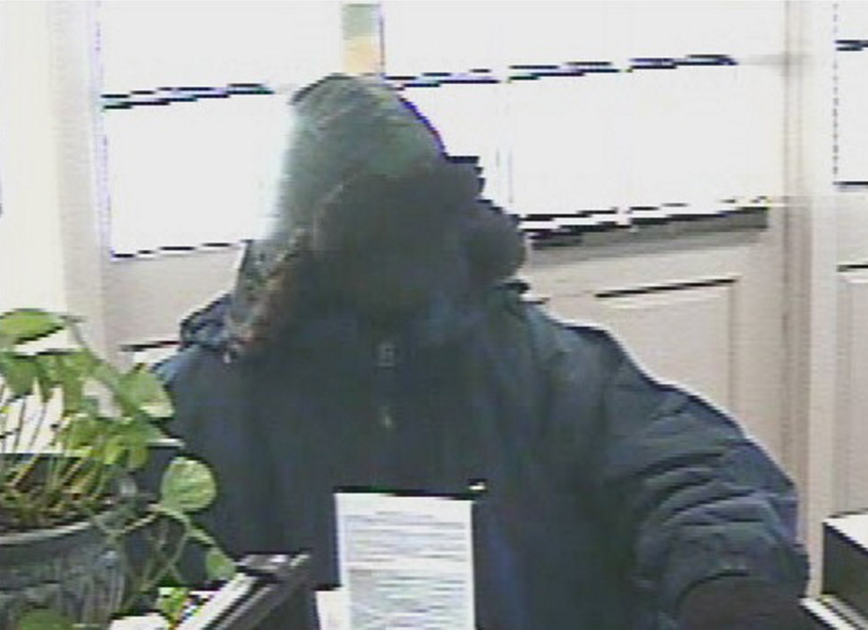 Bank robber seen in surveillance photograph at the Bangor Savings Bank in Pittsfield which was robbed on Feb. 7, 2014. He is suspected in three other bank robberies in the  area.