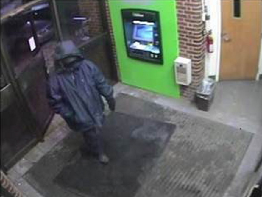 Bank robber seen in surveillance photograph at the TD  Bank in downtown Waterville which was robbed on Feb. 12. He is suspected in three other bank robberies in the area.