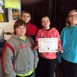 CAP.cutline_standalone:Waterville's South End Teen Center members, from left, Jacob Eads, Kaleb Moulten, Lauren Demo and Charlie Williams display a certificate from the Mid-Maine Homeless Shelter in recognition for being a community helper. The teens sold crafts during the holiday season and then donated to help the shelter.