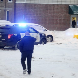 Police approach an entrance of the former MaineGeneral hospital on Chestnut Street in Augusta Jan. 12, a few minutes after a shooting in which an Augusta police officer shot a mentally ill man.