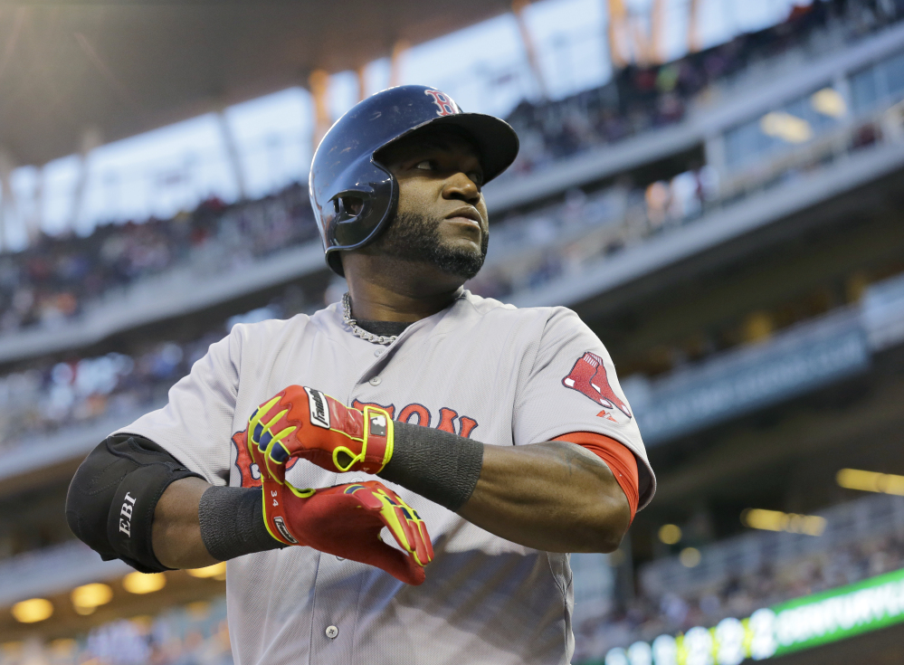 In this May 2014 file photo, Boston Red Sox designated hitter David Ortiz prepares to bat during the fourth inning of a game against the Minnesota Twins in Minneapolis. Major League Baseball is making some changes to speed up the length of games but it won't implement some of the more radical proposals to make games shorter.