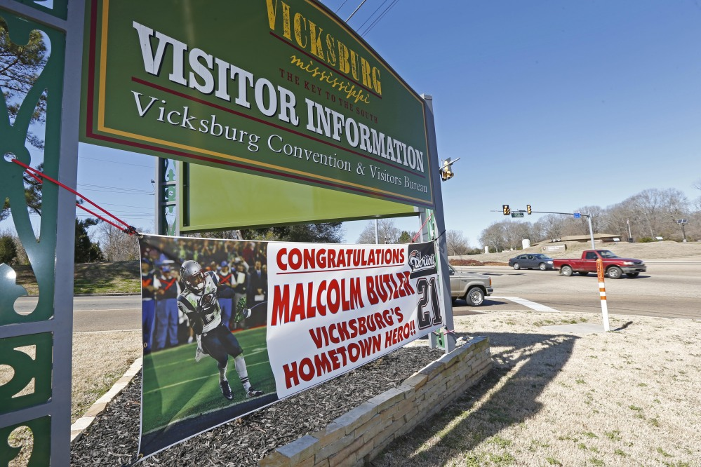 The sign for the city of Vicksburg, Miss., visitor's center shares space with a newer sign touting Super Bowl hero and New England Patriots cornerback Malcolm Butler as a hometown hero. The city is holding a parade in Butler's honor on Saturday.