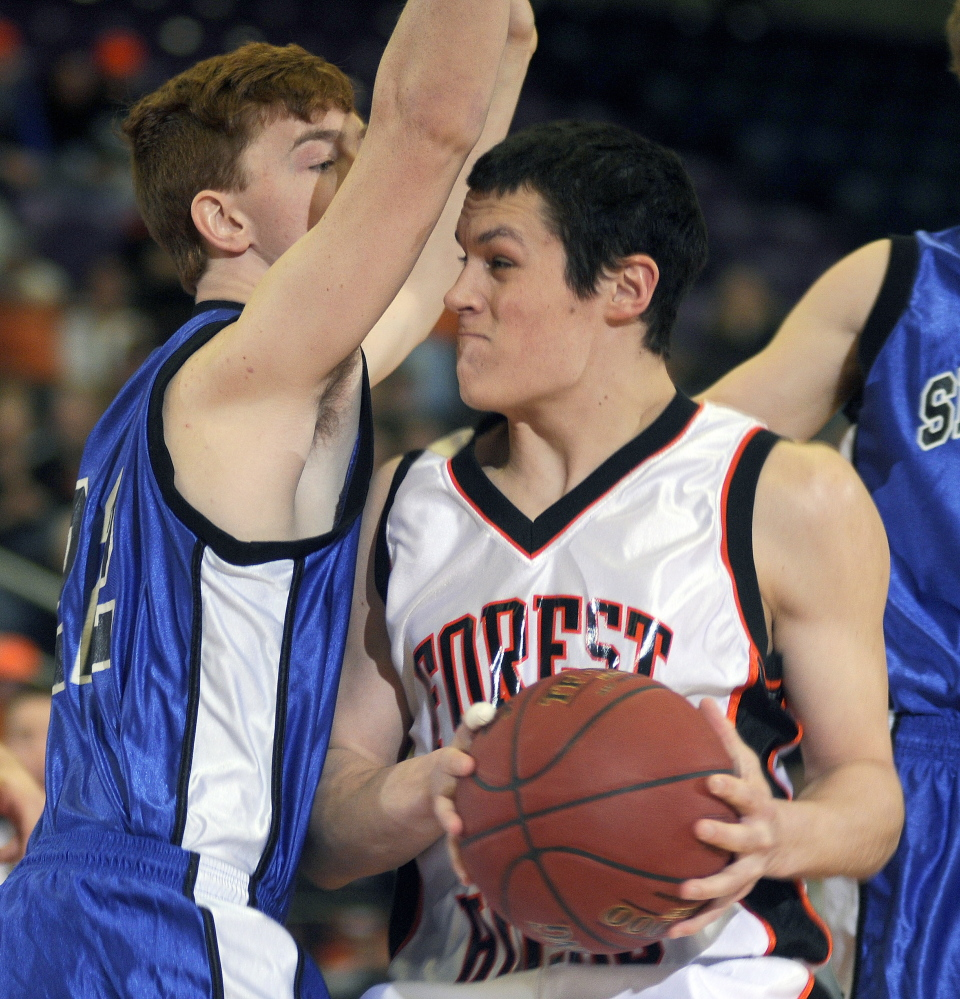 Forest Hills' Matt Turner, right, looks for an opening around Seacoast Christian's Sky Archer during a Western D semifinal Wednesday at the Augusta Civic Center. Turner and the top-seeded Tigers will face No. 3 Hyde in the Western D final Saturday at 2:45 p.m.