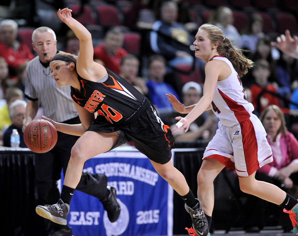 Gardiner Area High School's Morgan Carver (10) gets fouled by Camden Hills High School's Mara Dostie in the second half of the Eastern Class B semifinals Wednesday at the Cross Insurance Center in Bangor. Gardiner defeated Camden Hills 53-42.