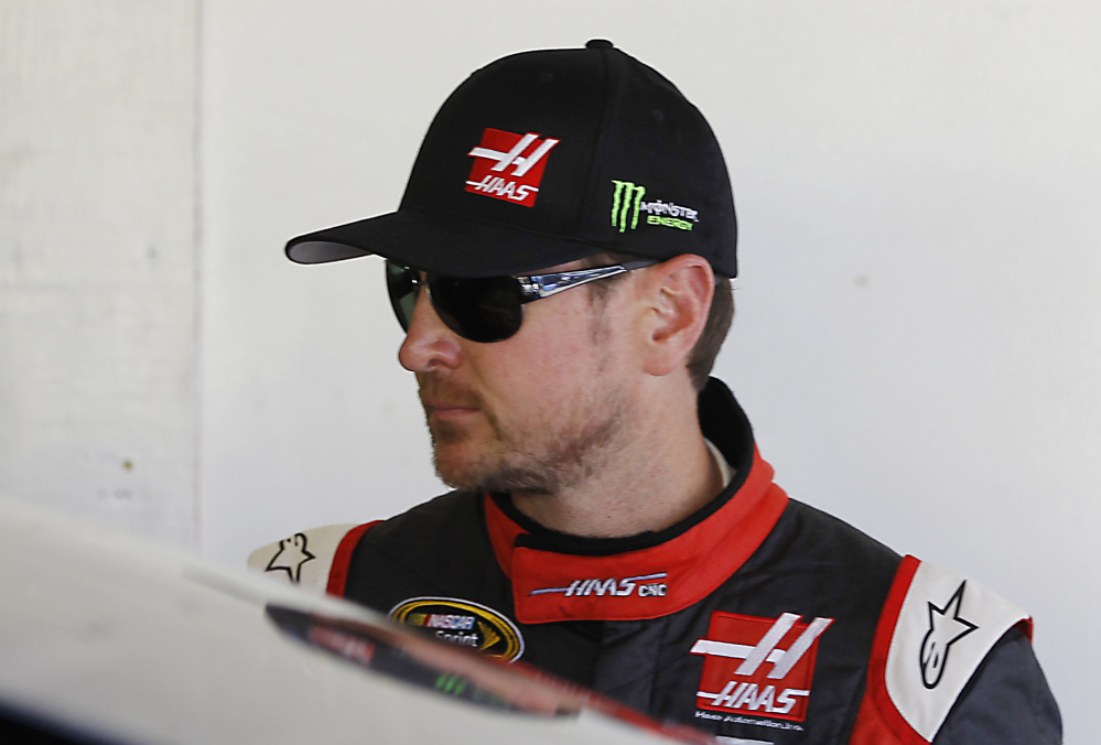 Kurt Busch stands in his garage during a practice session for the Daytona 500 on Wednesday.