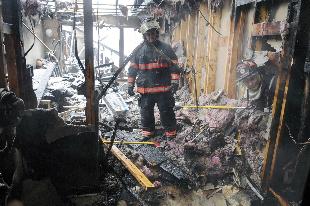 Firefighters attack the Feb. 5 blaze at Highland Terrace in Gardiner, which displaced about 30 people.
