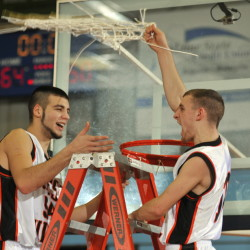 Forest Hills senior center Tanner Daigle, left, and senior guard Brandon Ouellette celebrate after cutting down an Augusta Civic Center net to celebrate their Western D title.