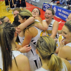 The Maranacook Black Bears celebrate after defeating Dirigo 47-37 in the Western Class C championship game Saturday at the Augusta Civic Center.