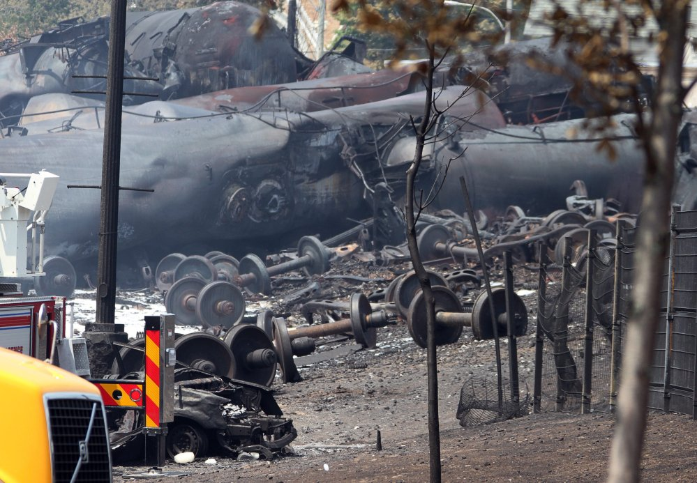 Debris is shown from a runaway train in July 2013 in Lac-Megantic, Quebec. As investigators in West Virginia and Ontario pick through the wreckage from the latest pair of oil train derailments to result in massive fires, U.S. transportation officials predict many more catastrophic wrecks involving flammable fuels in coming years absent new regulations.