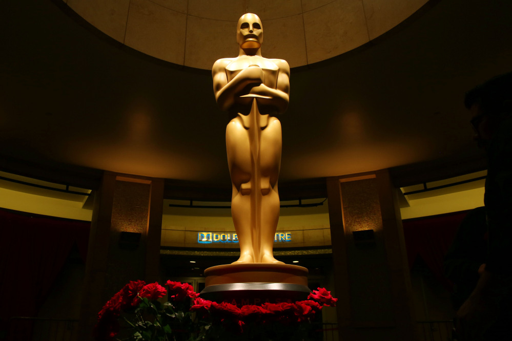 An Oscar statue is seen as preparations are made for the 87th Academy Awards in Los Angeles, Saturday.