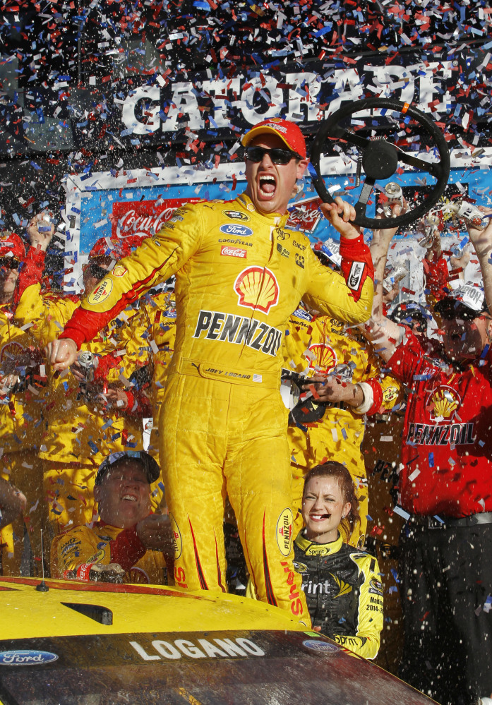 Joey Logano celebrates in Victory Lane after winning the Daytona 500 on Sunday at Daytona International Speedway in Daytona Beach, Fla.