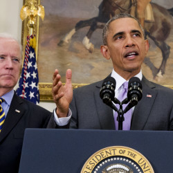 In this Feb. 11, file photo, Vice President Joe Biden listens as President Barack Obama speaks about the Islamic State group, Wednesday, in the Roosevelt Room of the White House in Washington.