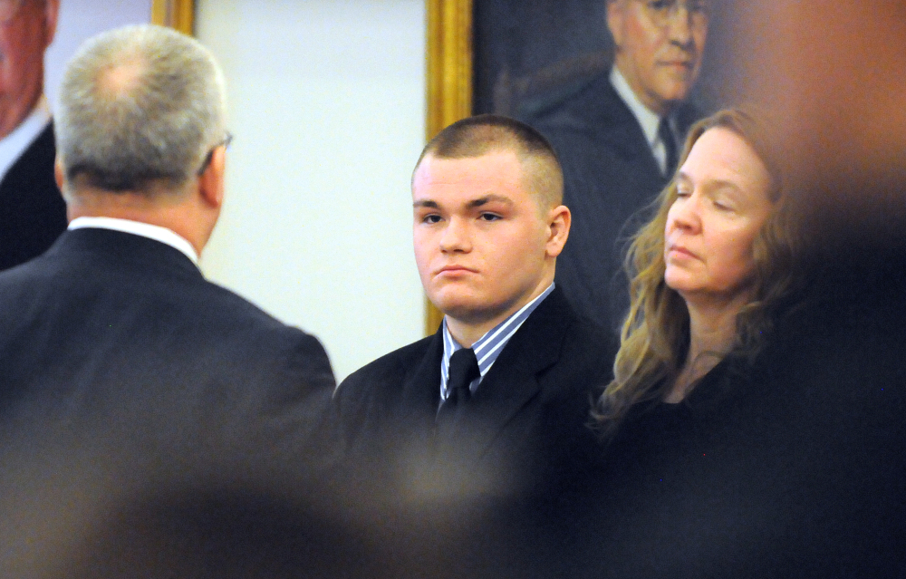 Kyle Dube, center, with his attorneys Stephen Smith, left, and Wendy Hatch is in court during the first day of Dube's trial at the Penobscot Judicial Center in Bangor on Monday. Dube is charged with kidnapping and murder in the 2013 death of Nichole Cable, a high school sophomore from Glenburn.