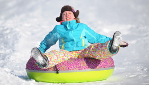 Snow tubing is one of the big outdoor sports of the winter, aided by deep snow left by a series of  February snowstorms.  At the Quarry Road Recreation Area in Waterville, Katie Stevens, 12, speeds down the hill on her inner tube on a sunny and cold Friday.