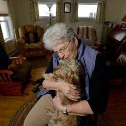 Dot Titcomb poses for a portrait with her dog, Molly, on Feb. 12 at her home in Chesterville. Titcomb receives weekly visits from local police to make sure she is safe. The visits are part of a program that resembles one being launched next week in Gardiner.
