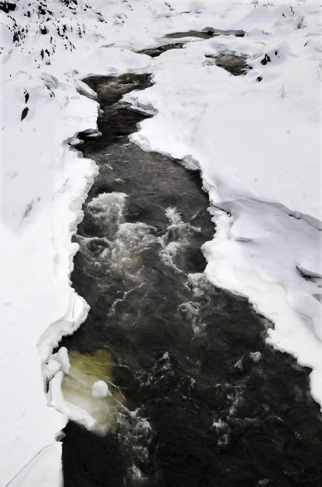 A combination of high water, melting snow and ice jams could lead to flooding this spring near where the Carrabassett River, pictured in Anson, flows into the Kennebec River in Madison.