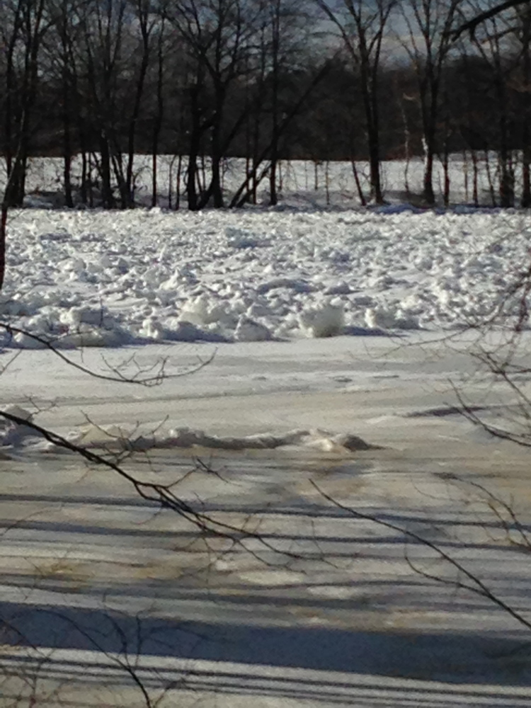 An ice jam on the Kennebec River in Madison, seen in a Jan. 28 photo, has experts worried that a rapid melting of snow might combine with the ice jams to cause spring flooding.