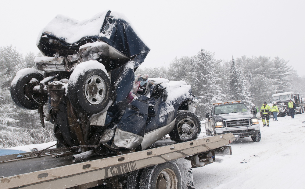 Carmel, Maine-02-25-2015-- What is left of a pick up truck is hauled away from a mutiple car pileup on intersate 95 in Carmel.   Kevin Bennett Photo
