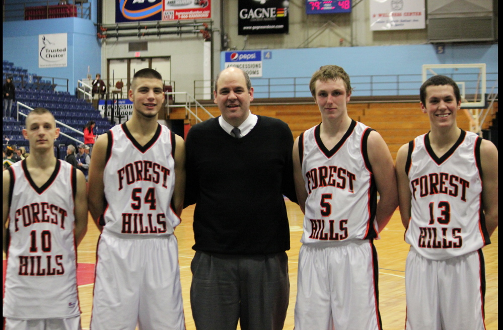 The Forest Hills boys basketball team is back in the Class D state title game. From left are Brandon Ouellette, Tanner Daigle, coach Anthony Amero, Ryan Petrin and Matt Turner.