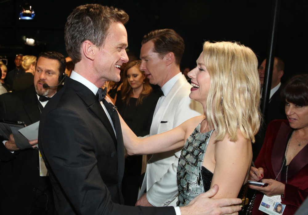 Neil Patrick Harris, left, and Naomi Watts greet backstage at the Oscars on Sunday at the Dolby Theatre in Los Angeles.