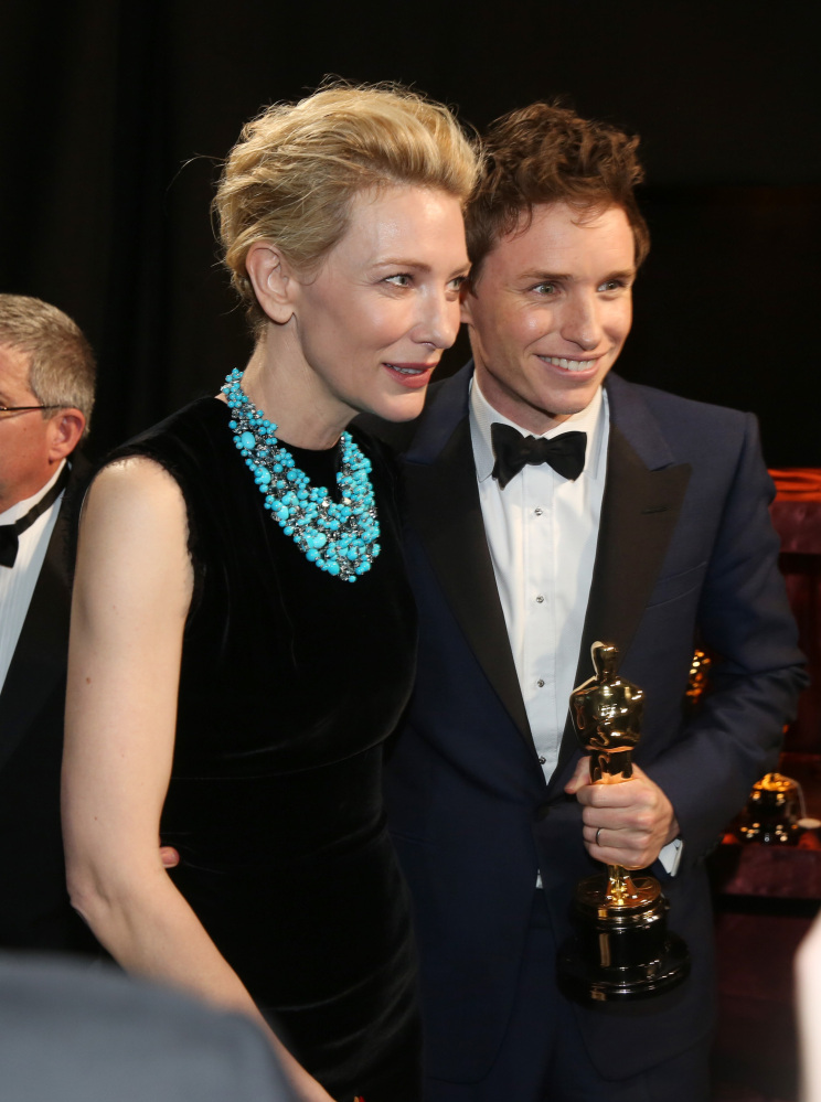 """Cate Blanchett, left, and Eddie Redmayne appear backstage with his award for best actor in a leading role for """"The Theory of Everything"""" at the Oscars on Sunday at the Dolby Theatre in Los Angeles.."""