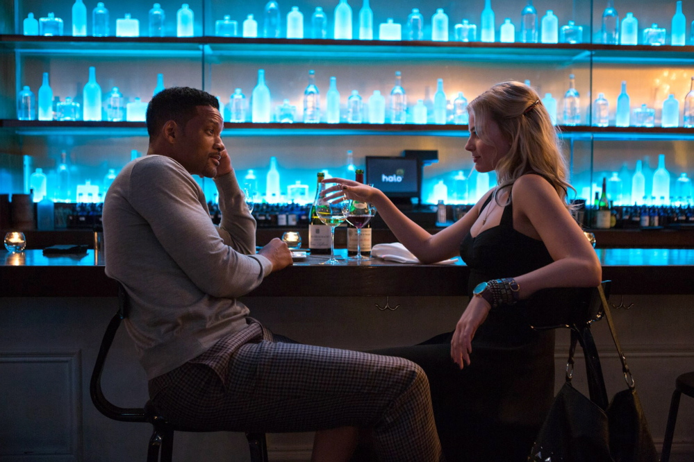 """Contributed photo   Will Smith, left, and Margot Robbie in """"Focus."""""""