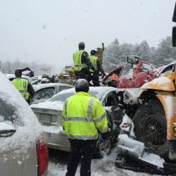 "A RSU 19 school bus came to rest on top of a car in the I-95 car crash on Wednesday.  Waterville firefighter Allen Nygren, who joined rescue efforts when he came across the scene, said it was ""the hand of God"" that prevented the sole passenger in the vehicle under the bus'  front end from being killed when his car was crushed."