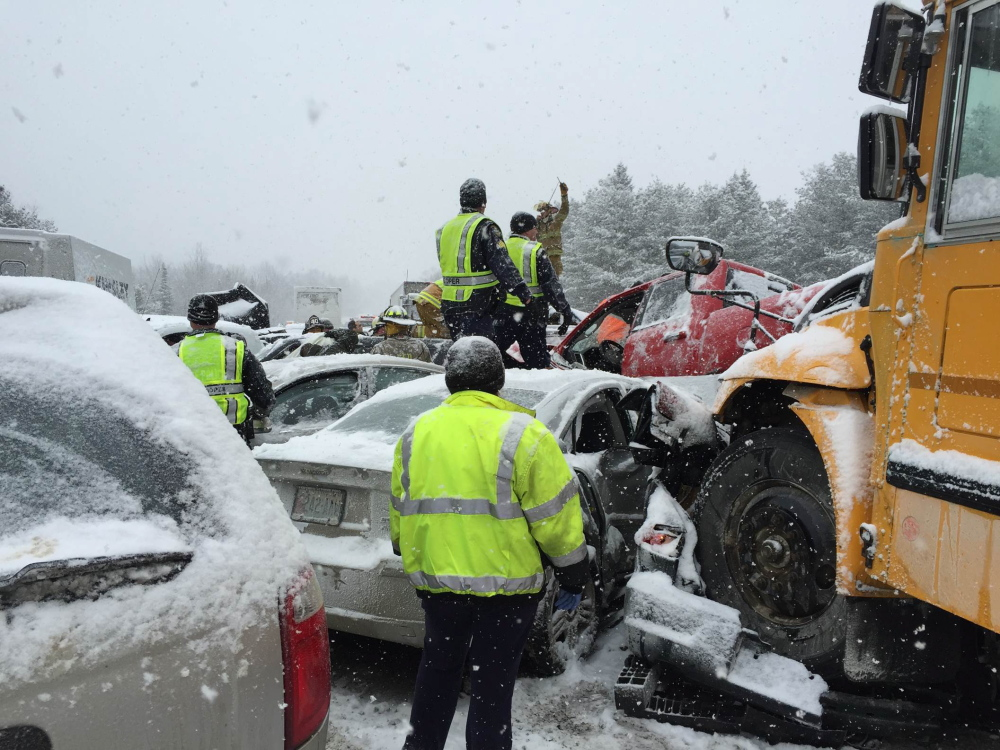 """A RSU 19 school bus came to rest on top of a car in the I-95 car crash on Wednesday.  Waterville firefighter Allen Nygren, who joined rescue efforts when he came across the scene, said it was """"the hand of God"""" that prevented the sole passenger in the vehicle under the bus'  front end from being killed when his car was crushed."""