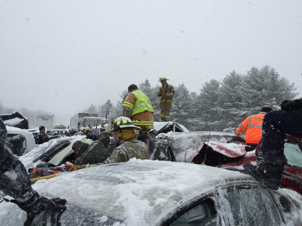 Rescue workers were forced to walk across the scene of Wednesday's car crashes by maneuvering from the the tops of some of the  75 cars involved; there was no room to walk between vehicles.