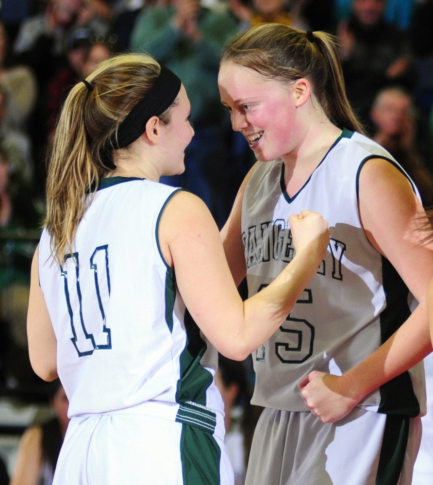 Rangeley's Seve Deery-Raps, left, gets encouragement from teammate Taylor Esty before shooting another foul shot during the Western Maine Class D semifinal game earlier this month at the Augusta Civic Center. The Lakers will play Washburn for the Class D state title at 1:05 p.m., Saturday at the Cross Insurance Center in Bangor.