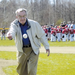 Dick McGee tosses the first pitch to open the 50th season of Police Athletic League baseball in Fairfield in 2007.