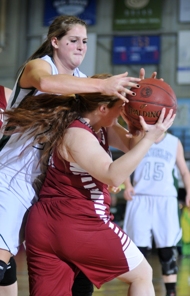 Rangeley junior forward Blayke Morin, left, tries to steal the ball from Richmond junior forward Kalah Patterson during the Western D championship game last Saturday at the Augusta Civic Center. Morin and the Lakers will play for the Class D state title Saturday against Washburn.