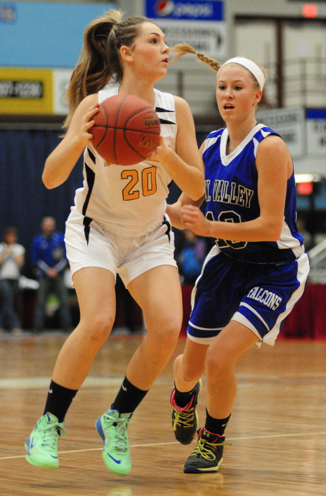 Marancook senior guard Lauren Clough, left, tries to get around Mountain Valley sophomore guard Emily Laubauaskas during a Western C semifinal Feb. 20 at the Augusta Civic Center. Maranacook will go for the Class C state title Saturday against Houlton.