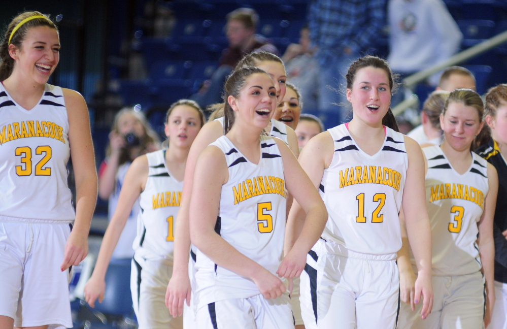 Maranacook players Christine Miller, left, Sarah Clough, Catherine Sanborn and Kristien Hall walk off the Augusta Civic Center court after they sank Mountain Valley in a Western C semifinal Feb. 20.