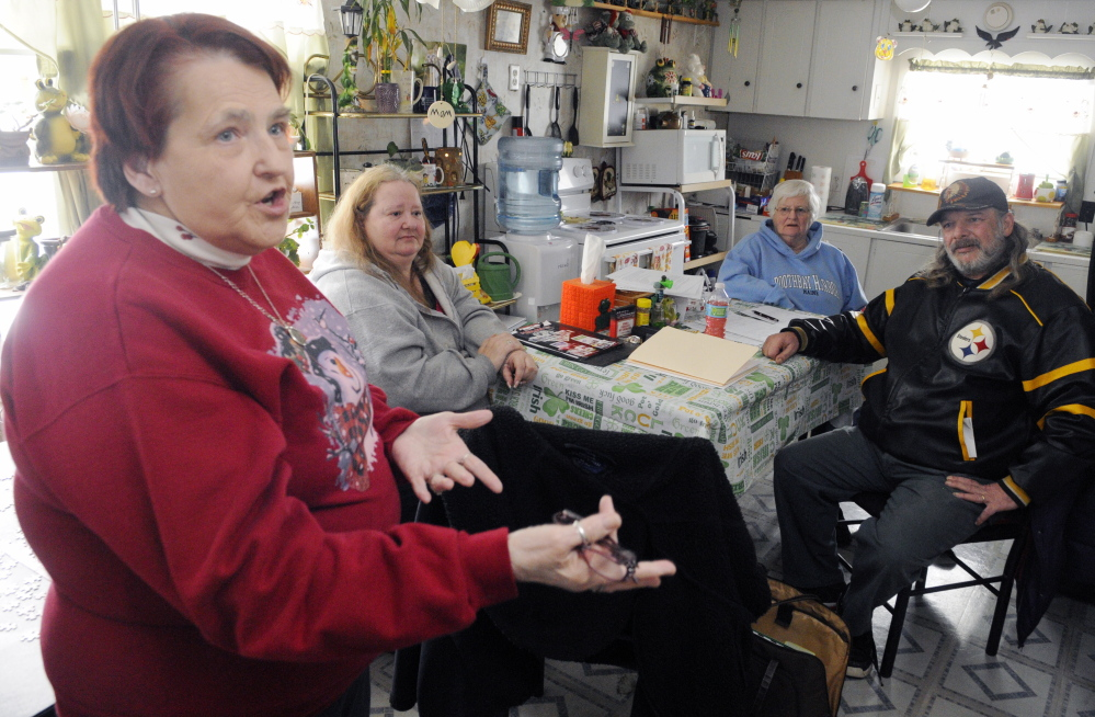 Deer Ridge Mobile Home Park co-op board secretary Beverly Chase, left, speaks during an interview on Thursday in Augusta. Other board members are vice president Donna Dennis, second from left, treasurer Gertrude Turcotte and president Mike Morissette.