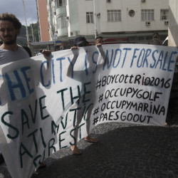 Activists hold a banner during a protest at the hotel where International Olympic Committee meeting in Rio de Janeiro on Saturday.