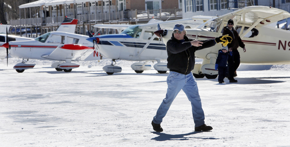 Ice runway manager Paul LaRochelle, parks planes in Alton Bay on frozen Lake Winnipesaukee on Saturday Alton, N.H.  LaRochelle and his crew work to plow and keep the only ice runway in the lower 48 states approved by the Federal Aviation Administration open to pilots.