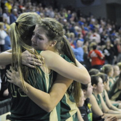 Rangeley teammates Taylor Esty, 15, left, and Blayke Morin, 20, console each other after losing 60-54 to Washburn in the Class D state championship game Saturday at the Cross Insurance Center in Bangor.