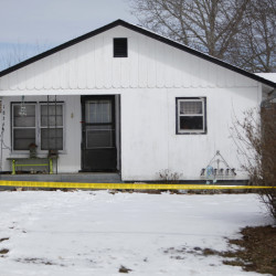 Police tape surrounds one of five crime scenes near Tyrone, Mo., on Friday morning.