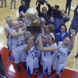 The Lawrence Bulldogs celebrate with the Gold Ball after beating Thornton Academy 50-43 for the Class A state championship Saturday at the Augusta Civic Center.