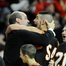 Forest Hills High School head basketball coach Anthony Amero celebrates with Tanner Daigle after defeating Fort Fairfield High School 51-45 in the Class D state championship game Saturday at the Cross Insurance Center in Bangor.