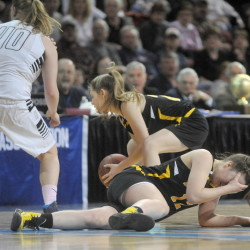 Maranacook High School's Catherine Sanborn, 12, holds her head after a collision with Houlton High School's Katie Condon, 40, in the second half Saturday of the Maine Principal's Association Class C championship at the Cross Insurance Center in Bangor. Houlton defeated Maranacook 59-51.