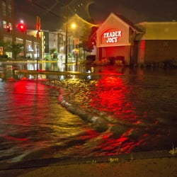 Floodwaters engulf Preble Street near the Trader Joe's store on Marginal Way in Portland after heavy rains last August. Much of the Bayside neighborhood is located in a flood zone because of its low elevation.
