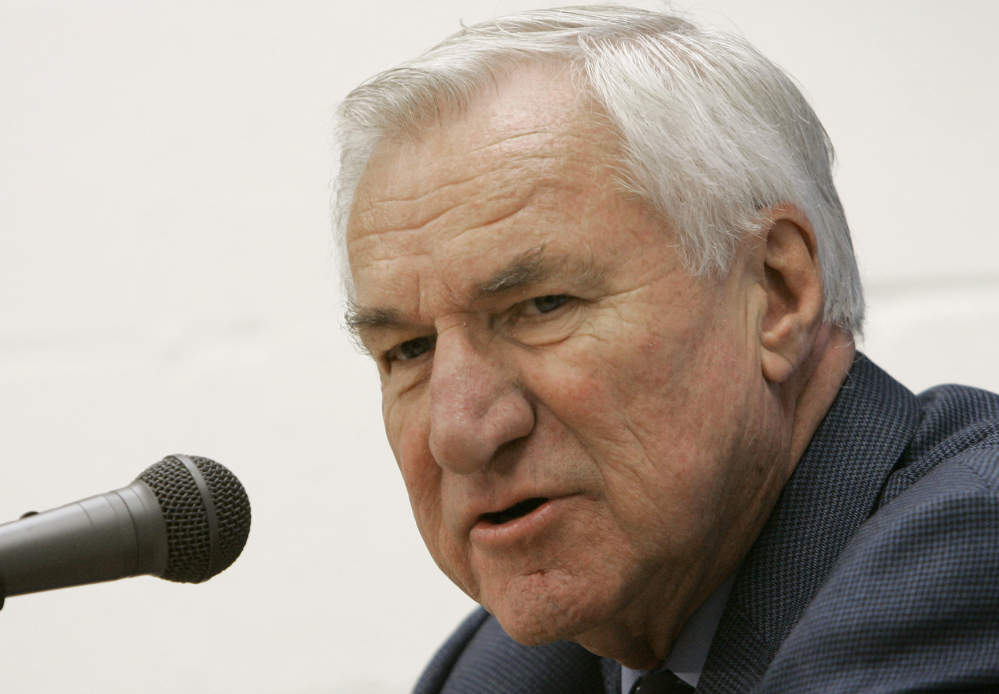 """Dean Smith, the North Carolina basketball coaching great who won two national championships, died """"peacefully"""" at his home Saturday night the school said in a statement Sunday from Smith's family. He was 83."""